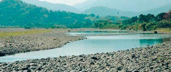 El río Yuna prácticamente ha desaparecido por el lugar donde se extraen los materiales. Foto EZEQUIEL GIL